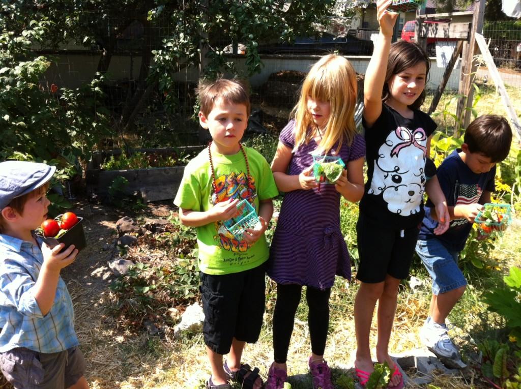 Group of children standing outdoors in garden