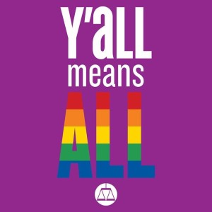 In white leters against a purple background, a caption reads, 'Y'all means ALL,' with the word 'ALL' in rainbow colors. Beneath the caption is a purple on white scales-of-justice logo inside a circle.