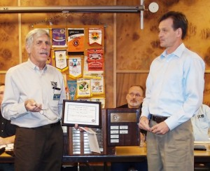 John Wieczorek, at right, accepts the Citizen of the Year award from the Ashland Lions Club