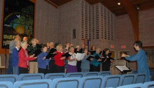 RVUUF choir members singing in RVUUF's Great Hall